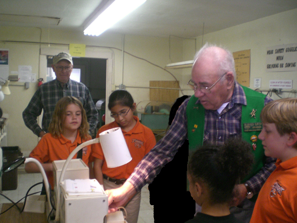 Harold Ervin shows Troop 92 the use of a Genii